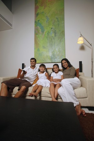 Family watching tv together photo