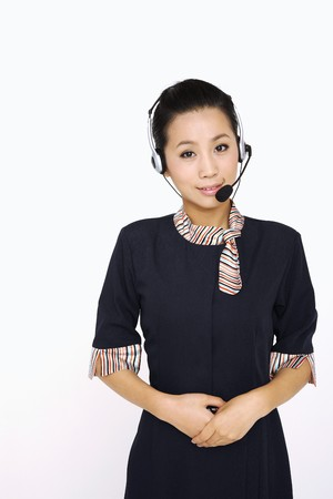 Female flight attendant with microphone headset photo