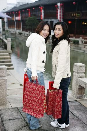 Women carrying paper bags photo