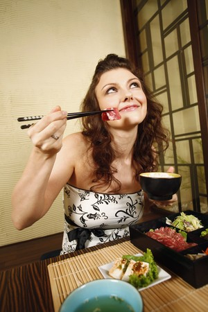 Woman having japanese set meal Stock Photo - 7644228