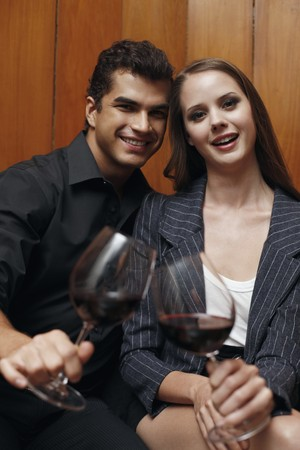 Man and woman with their glasses of wine photo