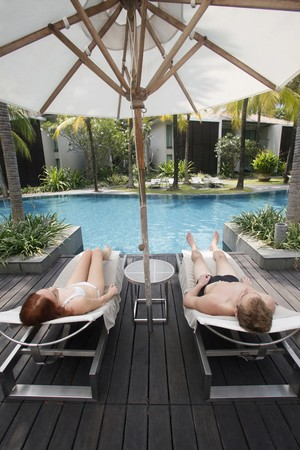 australian ethnicity: Man and woman resting on lounge chair Stock Photo