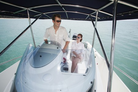 Man steering speedboat, woman sitting beside him Stock Photo - 7644132