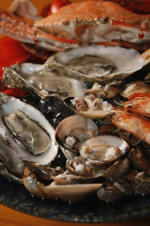 mussels: Seafood platter with sydney rock oysters, black and blue crab, rock lobster, tiger prawns, mussels, clams and cockles  Stock Photo