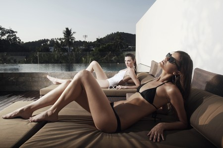 Women in bikini relaxing on lounge chair Stock Photo - 7644005