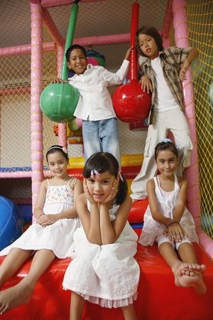 Children posing in indoor playground photo