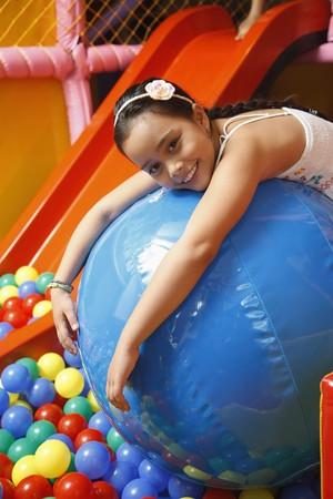 lying forward: Girl lying forward on blue ball Stock Photo