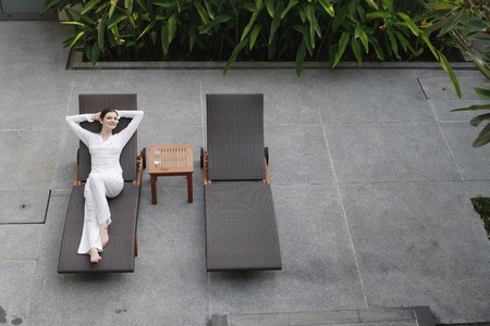 Woman relaxing on a lounge chair photo