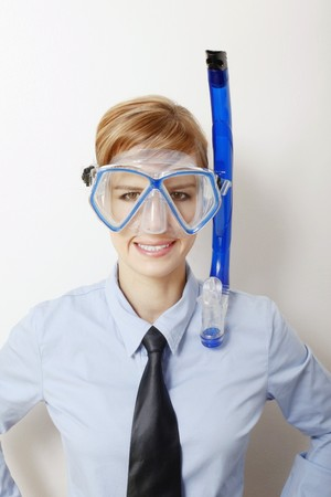Businesswoman with diving mask photo