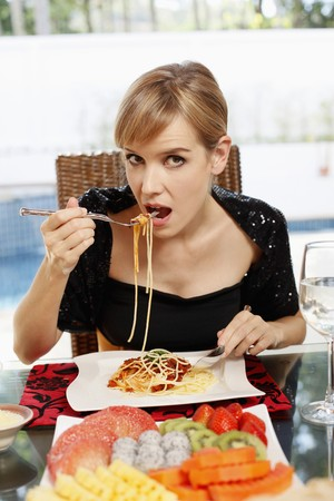 Woman enjoying a plate of spaghetti Stock Photo - 7644776