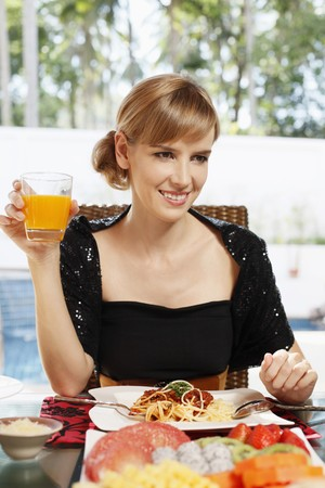Woman with a glass of orange juice photo