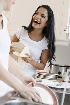 Women washing dishes in the kitchen Stock Photo - 7644772