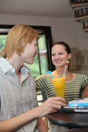 Man and woman chatting in a bar Stock Photo - 7668399