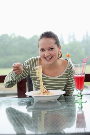 Woman enjoying a plate of pasta Stock Photo - 7668362