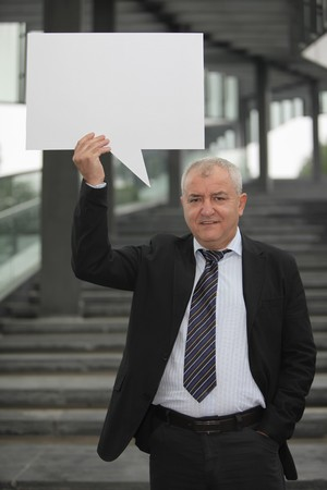 Businessman with a speech bubble photo