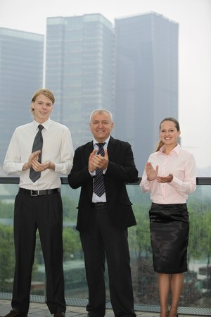 Business people applauding photo