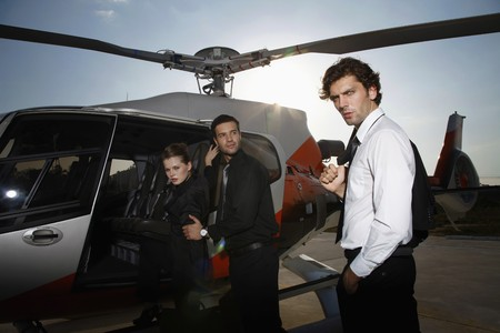 turkish ethnicity: Business people boarding helicopter
