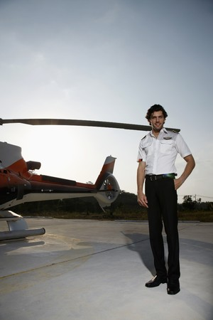 Pilot standing beside a helicopter