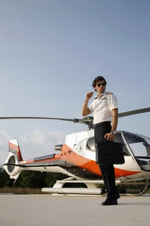 Pilot standing in front of a helicopter Stock Photo - 7685368