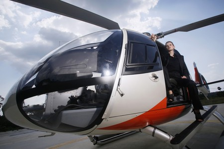 Businesswoman sitting in helicopter photo