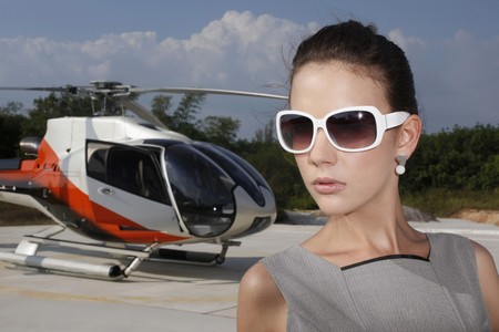 ukrainian ethnicity: Businesswoman wearing sunglasses with helicopter in the background