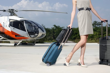helipad: Businesswoman with luggage and briefcase at helipad