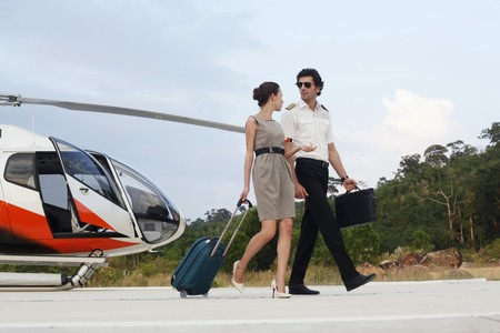 ukrainian ethnicity: Businesswoman walking away from helicopter with pilot
