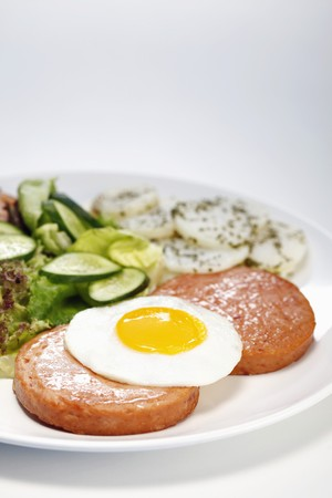 Meatloaf with sunny side up, garden salad and potatoes photo