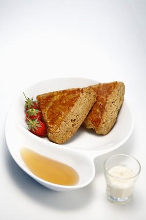 Walnut scones with honey, fresh cream and strawberries Stock Photo - 7685282