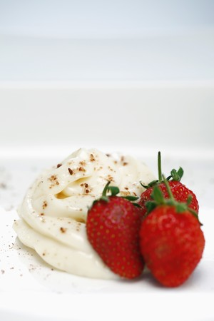 Strawberries and cream with a sprinkle of cocoa Stock Photo - 7685222