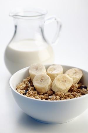 muesli: Breakfast of Muesli with banana, milk and honey Stock Photo