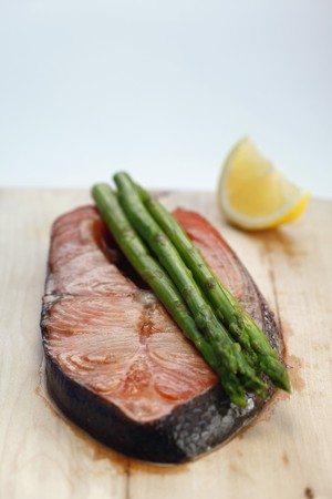 buttered: Salmon Steak with buttered asparagus Stock Photo