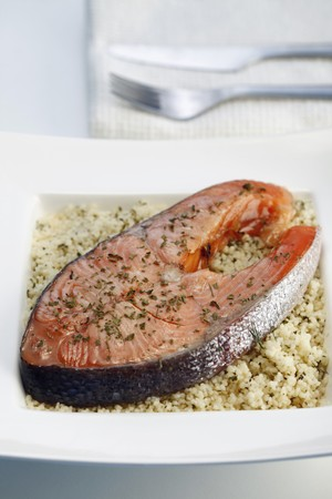 Salmon Steak with buttered couscous and fresh herbs photo