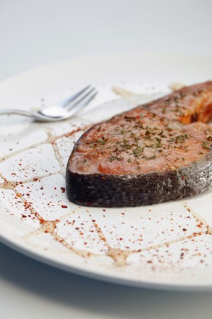 Grilled Salmon Steak with herbs and paprika photo