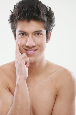 bare waist: Man smiling with hand on face Stock Photo