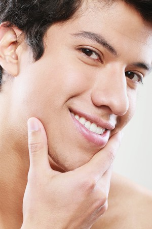 Man smiling with hand on chin photo