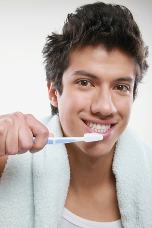 Man holding a toothbrush photo