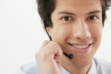 Businessman talking on headset Stock Photo