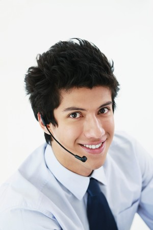Businessman with headset smiling photo