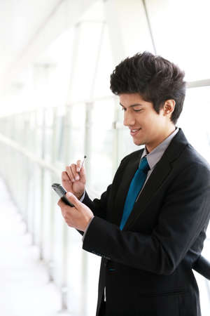 Businessman text messaging on phone photo