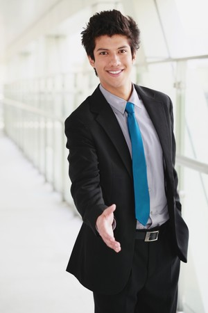 Businessman extending hand to shake photo