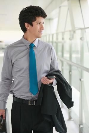 Businessman walking in a corridor Stock Photo - 7834403