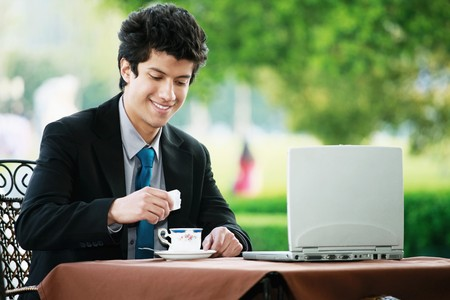 Businessman having tea at a cafe photo