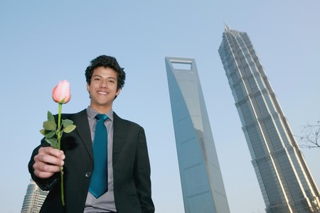 Businessman offering a rose photo