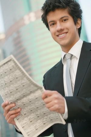Businessman reading newspaper Stock Photo - 7834906