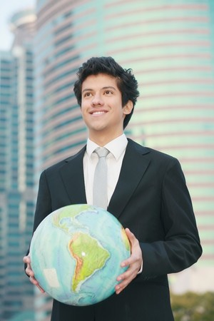 Businessman holding a globe photo