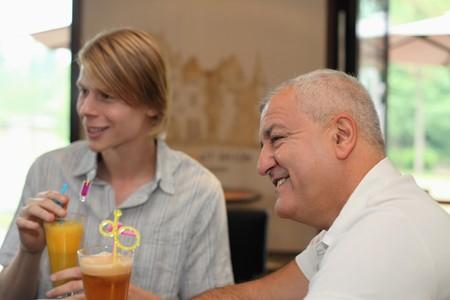 southern european descent: Men having drinks in bar Stock Photo