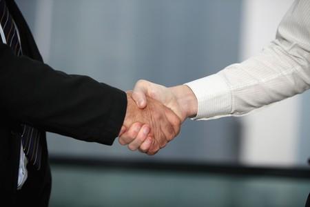 southern european descent: Businessmen shaking hands
