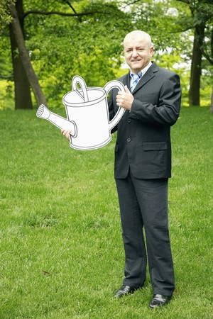 Businessman with watering can photo