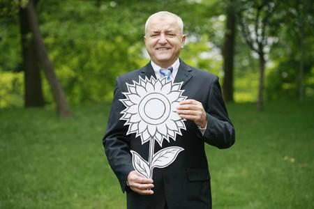 Businessman with sunflower photo